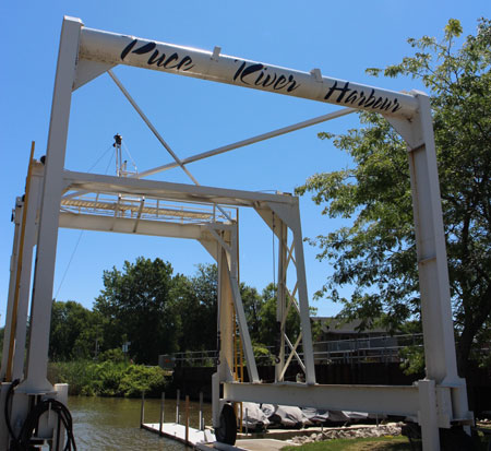 Puce River Sign